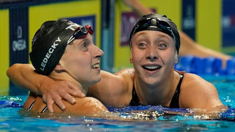 Katie Ledecky hugs Paige Madden, right, after winning the Women's 400 Freestyle during wave 2 of the U.S. Olympic Swim Trials
